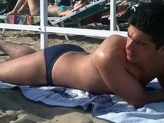 Italian guy teasing on A Riccione s beach in skimpy blue speedos fl
