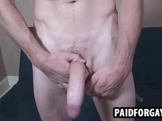 Muscular hunk jerking off for some money
