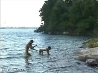 Hot naked bathers banging on the shore of the lake